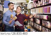 Купить «designer with shop list and brushes are looking color of paint», фото № 28833483, снято 16 февраля 2018 г. (c) Яков Филимонов / Фотобанк Лори