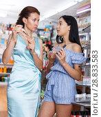 Купить «Woman and daughter looking new mascara in cosmetic store», фото № 28833583, снято 21 июня 2018 г. (c) Яков Филимонов / Фотобанк Лори