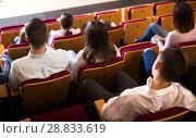 Купить «Adult audience expecting movie to begin», фото № 28833619, снято 3 декабря 2016 г. (c) Яков Филимонов / Фотобанк Лори