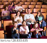 Купить «Numerous audience attending movie night with popcorn», фото № 28833635, снято 3 декабря 2016 г. (c) Яков Филимонов / Фотобанк Лори
