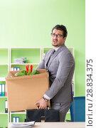 Купить «Male employee collecting his stuff after redundancy», фото № 28834375, снято 14 мая 2018 г. (c) Elnur / Фотобанк Лори