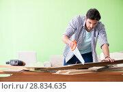 Купить «Woodworker working in his workshop», фото № 28834635, снято 15 мая 2018 г. (c) Elnur / Фотобанк Лори