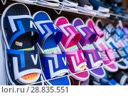 Купить «Резиновые сланцы в магазине», эксклюзивное фото № 28835551, снято 2 июня 2018 г. (c) Игорь Низов / Фотобанк Лори