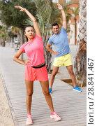 Купить «Couple training outdoors», фото № 28841467, снято 26 июня 2018 г. (c) Яков Филимонов / Фотобанк Лори