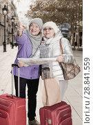 Mature ladies travellers with map. Стоковое фото, фотограф Яков Филимонов / Фотобанк Лори