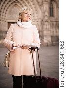 Купить «Mature woman with map and baggage», фото № 28841663, снято 27 ноября 2017 г. (c) Яков Филимонов / Фотобанк Лори