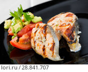 Купить «Grilled salmon with tomatoes, avocado on black dish», фото № 28841707, снято 22 августа 2018 г. (c) Яков Филимонов / Фотобанк Лори