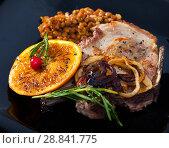 Купить «Pork steak, lentil, grilled orange», фото № 28841775, снято 11 июля 2020 г. (c) Яков Филимонов / Фотобанк Лори