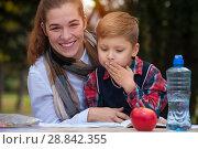 Купить «Beautiful positive mother and child», фото № 28842355, снято 9 ноября 2017 г. (c) Pavel Biryukov / Фотобанк Лори