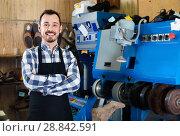 Купить «Male worker demonstrating workplace and tools in shoe», фото № 28842591, снято 2 февраля 2017 г. (c) Яков Филимонов / Фотобанк Лори