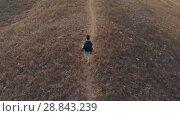 Купить «Man with backpack hiking aerial view», видеоролик № 28843239, снято 20 июля 2018 г. (c) Илья Шаматура / Фотобанк Лори