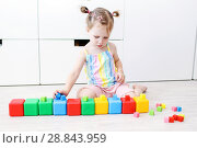 Купить «Cute little 2 years toddler girl playing with multicolored cubes at home on the floor», фото № 28843959, снято 23 июля 2018 г. (c) ivolodina / Фотобанк Лори