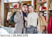Купить «Couple is satisfied shopping», фото № 28860039, снято 12 марта 2018 г. (c) Яков Филимонов / Фотобанк Лори