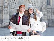 Купить «Smiling couple man and woman with map», фото № 28860051, снято 18 ноября 2017 г. (c) Яков Филимонов / Фотобанк Лори