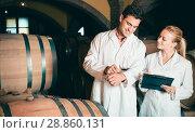 Купить «Two friendly wine house workers checking quality of product», фото № 28860131, снято 21 сентября 2016 г. (c) Яков Филимонов / Фотобанк Лори