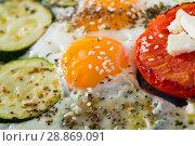 Купить «Image of plate with fried eggs with tomatoes and zucchini», фото № 28869091, снято 17 августа 2018 г. (c) Яков Филимонов / Фотобанк Лори
