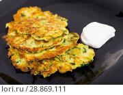 Купить «Pancakes from courgettes is tasty vegeterian dish», фото № 28869111, снято 15 октября 2018 г. (c) Яков Филимонов / Фотобанк Лори