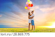 Купить «happy couple with balloons over sunset sky», фото № 28869775, снято 23 июля 2014 г. (c) Syda Productions / Фотобанк Лори