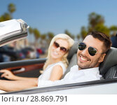 Купить «happy couple driving in convertible car», фото № 28869791, снято 15 июля 2015 г. (c) Syda Productions / Фотобанк Лори