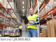 Купить «warehouse worker with clipboard in safety vest», фото № 28869863, снято 9 декабря 2015 г. (c) Syda Productions / Фотобанк Лори