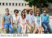 Купить «group of happy friends in sunglasses in city», фото № 28869999, снято 10 июня 2018 г. (c) Syda Productions / Фотобанк Лори