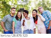 Купить «international friends taking selfie in park», фото № 28870123, снято 10 июня 2018 г. (c) Syda Productions / Фотобанк Лори