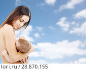 mother breast feeding baby over sky background. Стоковое фото, фотограф Syda Productions / Фотобанк Лори
