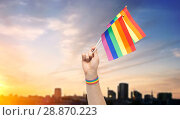 Купить «hand with gay pride rainbow flags and wristband», фото № 28870223, снято 2 ноября 2017 г. (c) Syda Productions / Фотобанк Лори