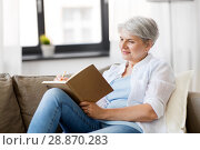 Купить «senior woman writing to notebook or diary at home», фото № 28870283, снято 24 мая 2018 г. (c) Syda Productions / Фотобанк Лори