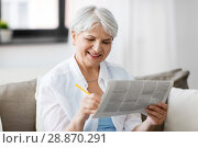 Купить «senior woman marking newspaper ad at home», фото № 28870291, снято 24 мая 2018 г. (c) Syda Productions / Фотобанк Лори