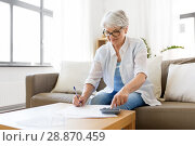 Купить «senior woman with money and bills at home», фото № 28870459, снято 24 мая 2018 г. (c) Syda Productions / Фотобанк Лори