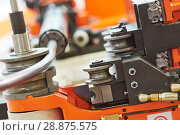 Купить «metal pipe bending machine», фото № 28875575, снято 16 мая 2018 г. (c) Дмитрий Калиновский / Фотобанк Лори