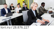 Купить «Mature businesswoman concentrated on work with laptop in office», фото № 28876227, снято 10 марта 2018 г. (c) Яков Филимонов / Фотобанк Лори