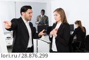 Купить «Male boss pointinting to misses in work to woman manager», фото № 28876299, снято 24 марта 2018 г. (c) Яков Филимонов / Фотобанк Лори