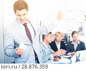 Купить «Angry manager dissatisfied with colleagues», фото № 28876359, снято 1 июля 2017 г. (c) Яков Филимонов / Фотобанк Лори