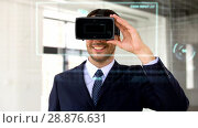 Купить «businessman with vr headset, score and coding», видеоролик № 28876631, снято 20 июня 2019 г. (c) Syda Productions / Фотобанк Лори