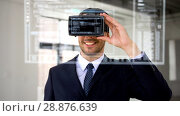 Купить «businessman with vr headset and virtual screen», видеоролик № 28876639, снято 20 июня 2019 г. (c) Syda Productions / Фотобанк Лори