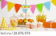 Купить «food, drinks and birthday present at party», видеоролик № 28876919, снято 13 июля 2018 г. (c) Syda Productions / Фотобанк Лори