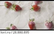 Купить «Close-up drops of milk and a bunch of ripe red strawberry fruit falls into a white plate with milk splashes. Top view. Slow motion. Soft focus. Full HD video, 240fps,1080p.», видеоролик № 28880895, снято 29 июня 2018 г. (c) Ярослав Данильченко / Фотобанк Лори