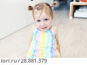 Купить «Cheerful cute little girl in the children's room», фото № 28881379, снято 23 июля 2018 г. (c) ivolodina / Фотобанк Лори