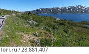 Купить «Автомобили и мотоциклы на стоянке на горной трассе в Норвегии», видеоролик № 28881407, снято 12 июля 2018 г. (c) Кекяляйнен Андрей / Фотобанк Лори