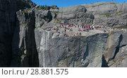 Купить «Подлет к скале Проповедника (Preikestolen). Туристическая природная достопримечательность. Норвегия», видеоролик № 28881575, снято 12 июля 2018 г. (c) Кекяляйнен Андрей / Фотобанк Лори