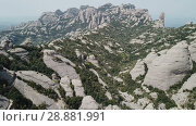 Купить «Aerial view of picturesque rocky landscape Montserrat, Spain», видеоролик № 28881991, снято 27 апреля 2018 г. (c) Яков Филимонов / Фотобанк Лори