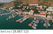 Купить «Aerial view of yachts and boats», видеоролик № 28887123, снято 18 июля 2018 г. (c) Илья Шаматура / Фотобанк Лори