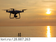 Купить «Professional drone quad copter with digital camera at sunset ready to fly for surveillance. close-up of Rotor UAV. four blade propeller drone. silhouette copter on beautiful sunset.», фото № 28887263, снято 22 июля 2018 г. (c) Алексей Ширманов / Фотобанк Лори