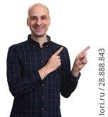 Купить «Happy bald handsome man in shirt pointing away», фото № 28888843, снято 25 июня 2017 г. (c) Александр Лычагин / Фотобанк Лори