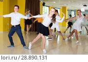 Купить «Positive children are dancing rock-n-roll in pairs», фото № 28890131, снято 13 июля 2017 г. (c) Яков Филимонов / Фотобанк Лори