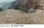 Купить «Man hiking aerial view», видеоролик № 28890795, снято 19 июля 2018 г. (c) Илья Шаматура / Фотобанк Лори
