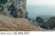 Купить «Hiker raises his hands», видеоролик № 28890807, снято 19 июля 2018 г. (c) Илья Шаматура / Фотобанк Лори