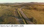 Купить «Aerial Shot of Car Moving on Curvy Mountain Road», видеоролик № 28891335, снято 20 июля 2018 г. (c) Илья Шаматура / Фотобанк Лори